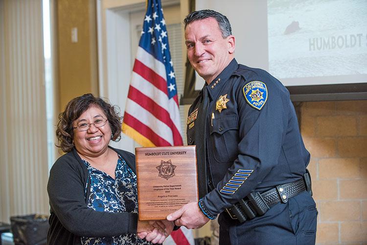 HSU Police Chief Donn Peterson, right, presents an award to lead dispatcher Angelica Preciado.