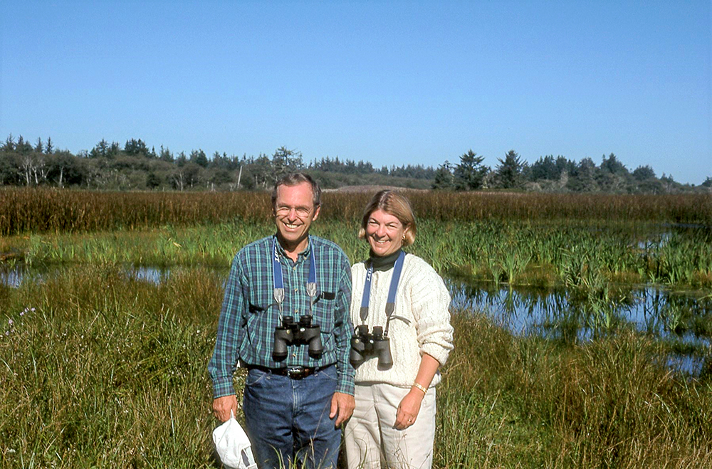 Don and Andrea Tuttle standing by a marsh