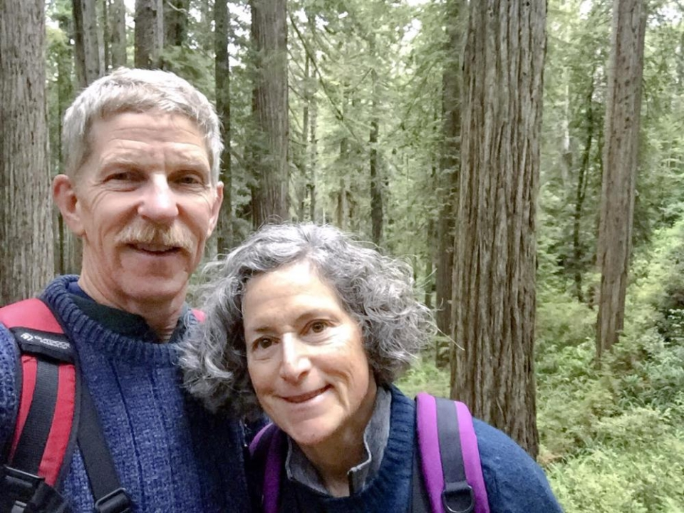 Eric Wier and Laura Frank hiking in the woods.